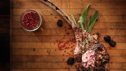 Grilled Veal Tomahawk Chop with Blackberry Pink Peppercorn Butter